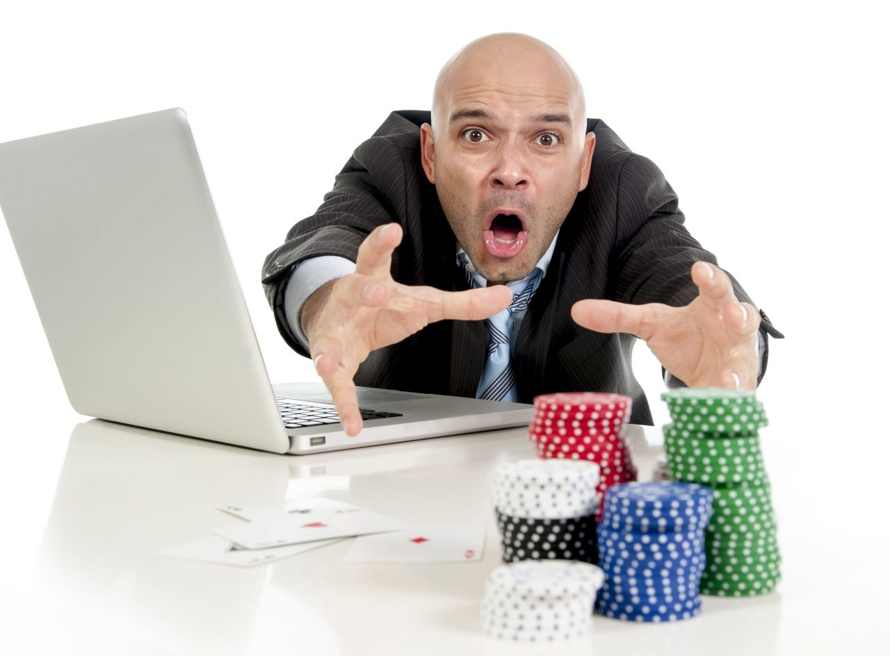 man losing money online gambling